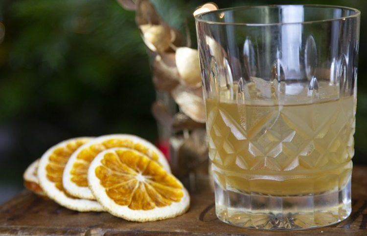 spiced orange old fashioned with dried orange slices