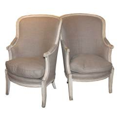 Upholstered Wingback Chair Tied To Pair Of French 19th Century Barrel Back Wing