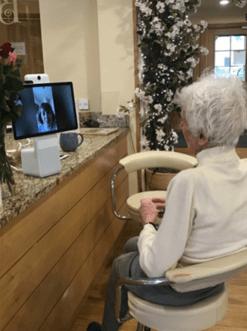 Elderly lady speaking to family member via Facebook Portal in Hertfordshire Care Home