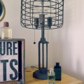 The industrial cage edison bulb rust metal table lamp caught austin