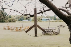 Peace sign made by Staving Artist hanging from tree at Fox Run