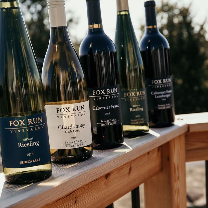 Five bottles of wine lined up on the front deck at Fox Run