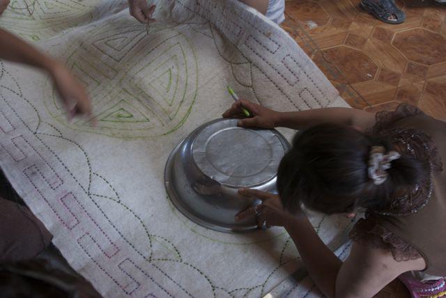 Laying Mongol felt rug design