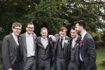 Grooms men wear DIY paper button hole flowers | Great Tythe Barn wedding photographer | Cotswold Gloucestershire | Yorkshire wedding photographer
