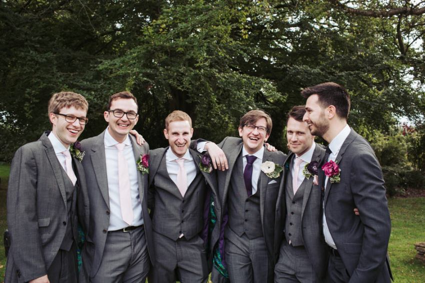 Grooms men wear DIY paper button hole flowers | Great Tythe Barn Tetbury wedding photographer | Cotswold Gloucestershire | Yorkshire wedding photographer