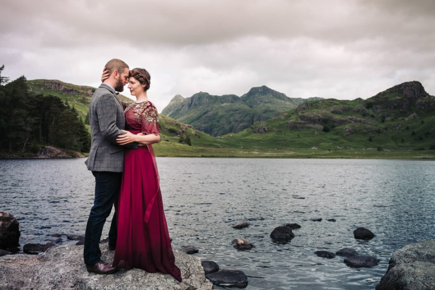 Bride in red dress with groom in tweed | Lake district wedding photography | wedding photographer Yorkshire UK