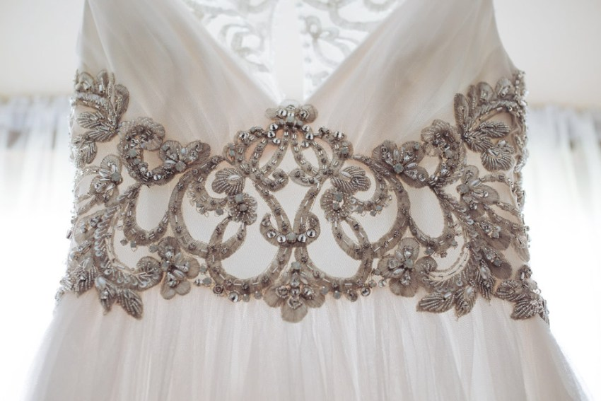 Detail of beautiful tulle and sliver embroidered wedding dress