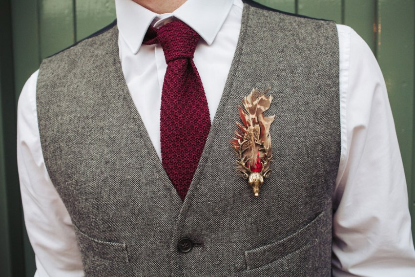 Groom tie detail with boho stag brooch | Oakwell Hall wedding