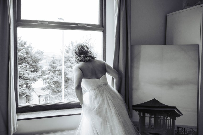 Bride peers out of window