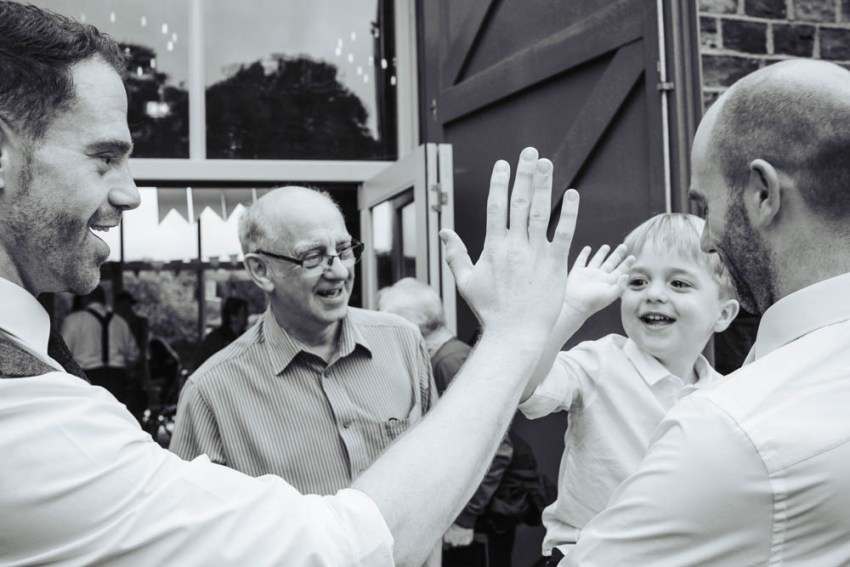 Groom and pageboy high fives