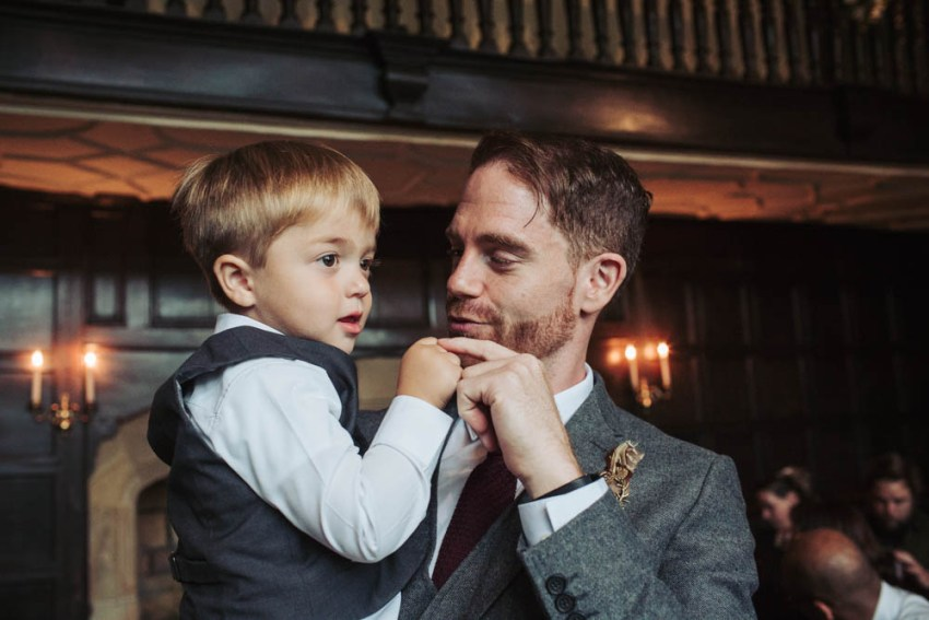 groom and pageboy in grey wool suit