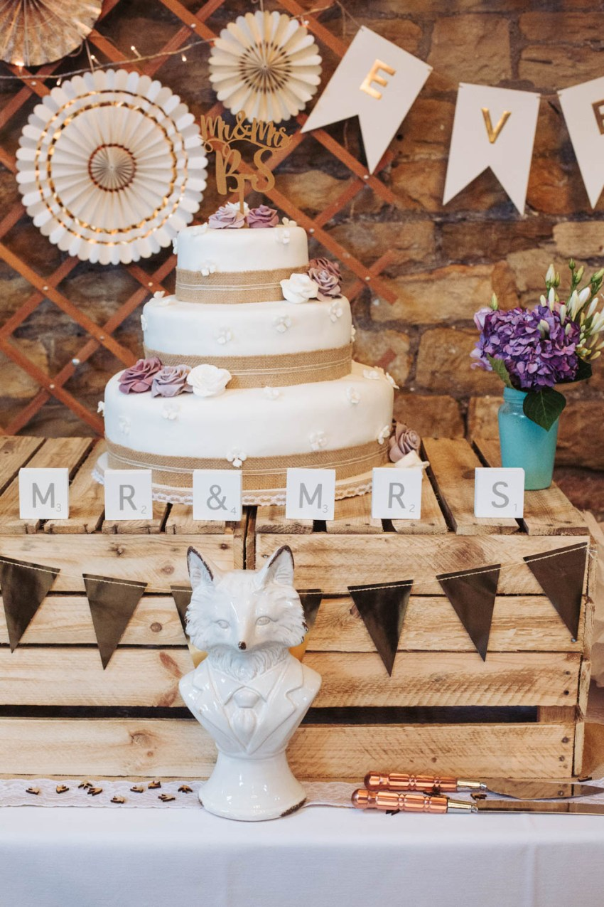 Ivory, white, gold and purple rustic wedding decorations with fox at Oakwell Hall.