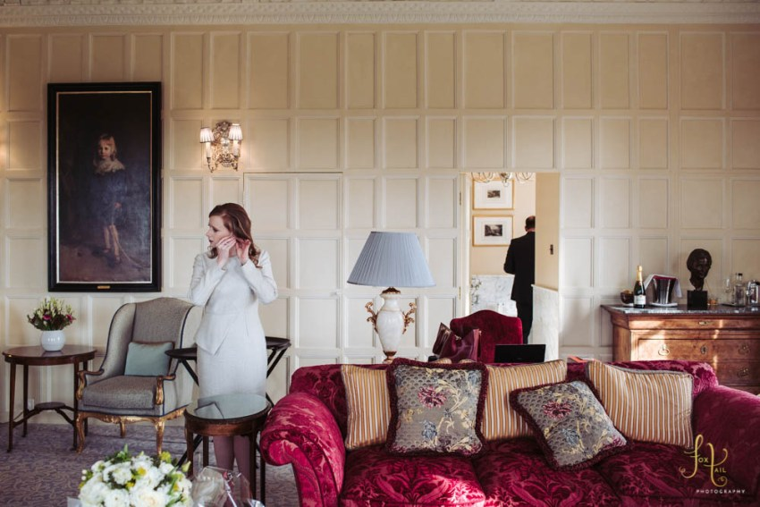 Bride and groom prepare in their suit at Cliveden House
