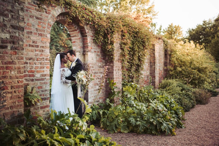 Saltmarshe Hall wedding photographer Yorkshire UK | natural wedding photography Leeds | Bride and groom in the waled garden