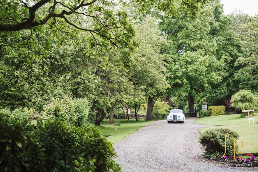 Classic car pull up the drive at Markington Hall.