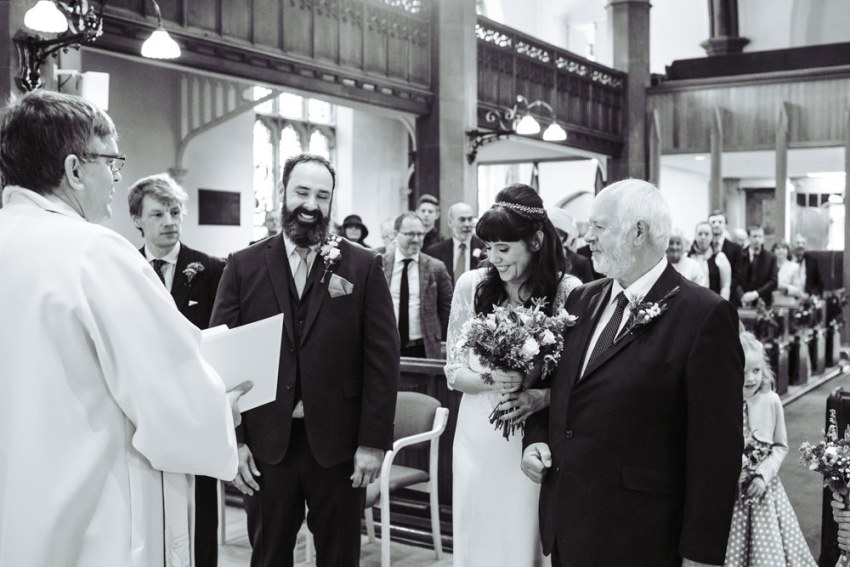 St. Paul's church shipley wedding. Father of the bride presents his daughter to the groom.