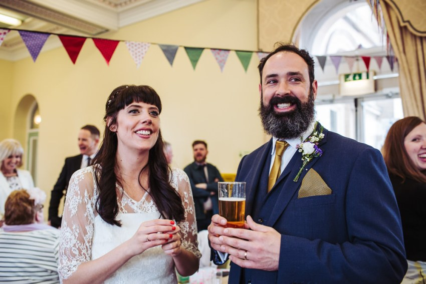 Bride and groom enjoy reception with guests at Victoria Hall.