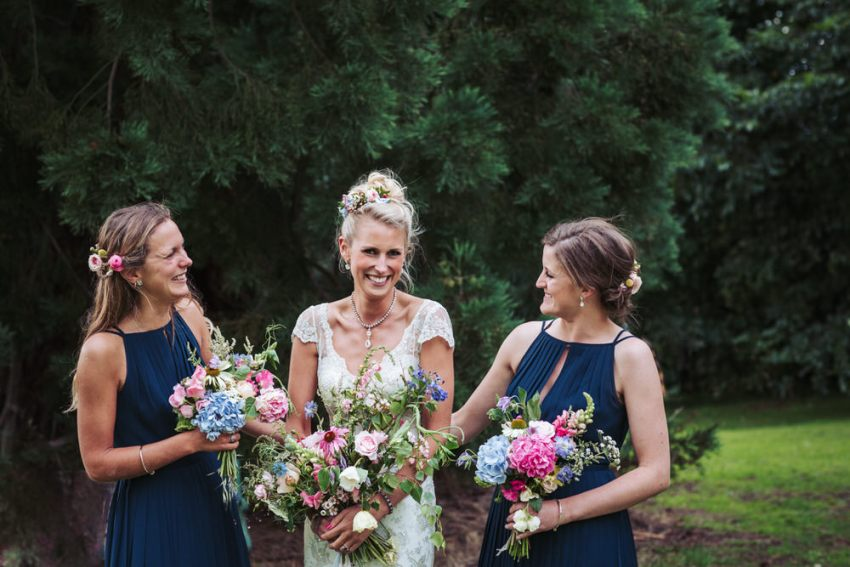 Bride in Liliana Dabic wedding dress, bridesmaids wear navy blue Ted Baker dresses, Manor Garden bouquets. Natural Harrogate wedding photographer.