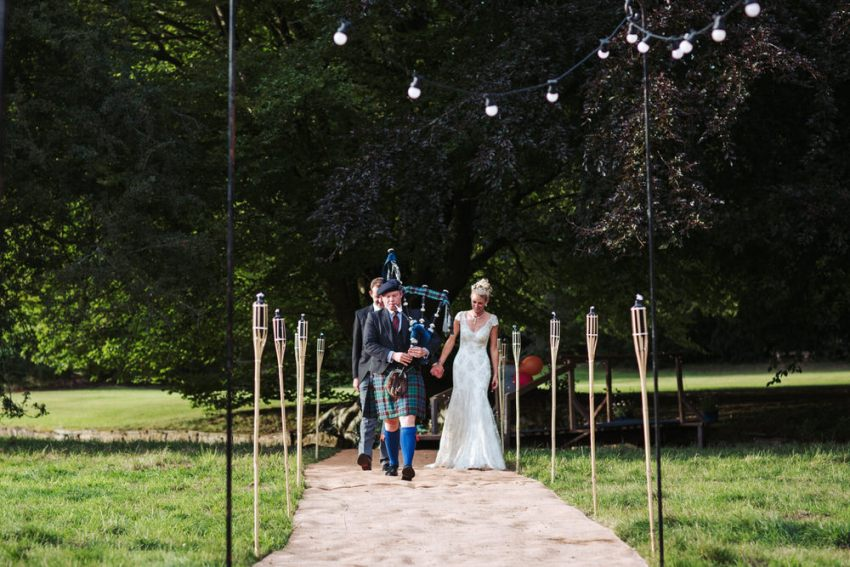 Bride and groom walked into reception by Scotsman playing bagpipes