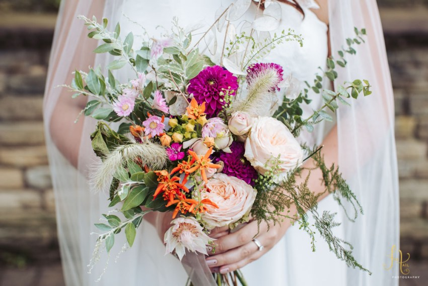 Grace and Thorn bridal wedding bouquet, cool and romantic boho bouquet in orange pink and purple.
