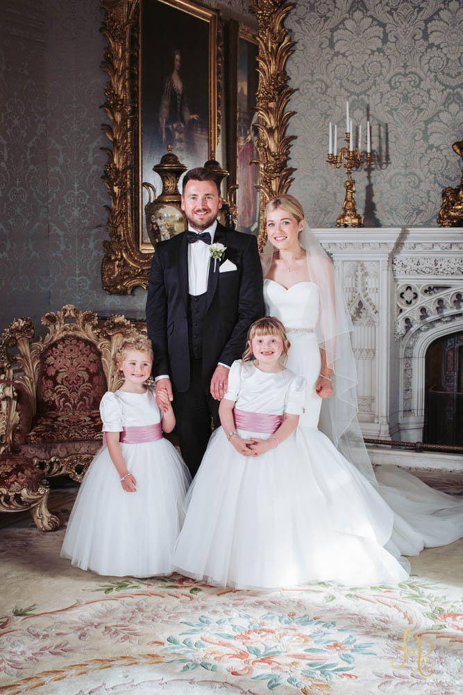 Allerton Castle wedding family photo. Bride and groom with flower girls.