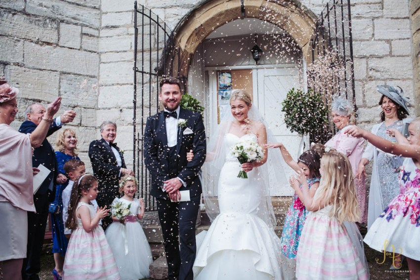 Confetti being thrown over newly weds at St. Peters Church in Bafferton near Harrogate.
