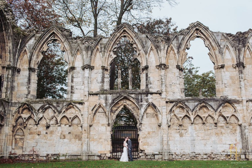 York Registry Office Wedding photography portrait of bride and groom in the Museum Gardens.