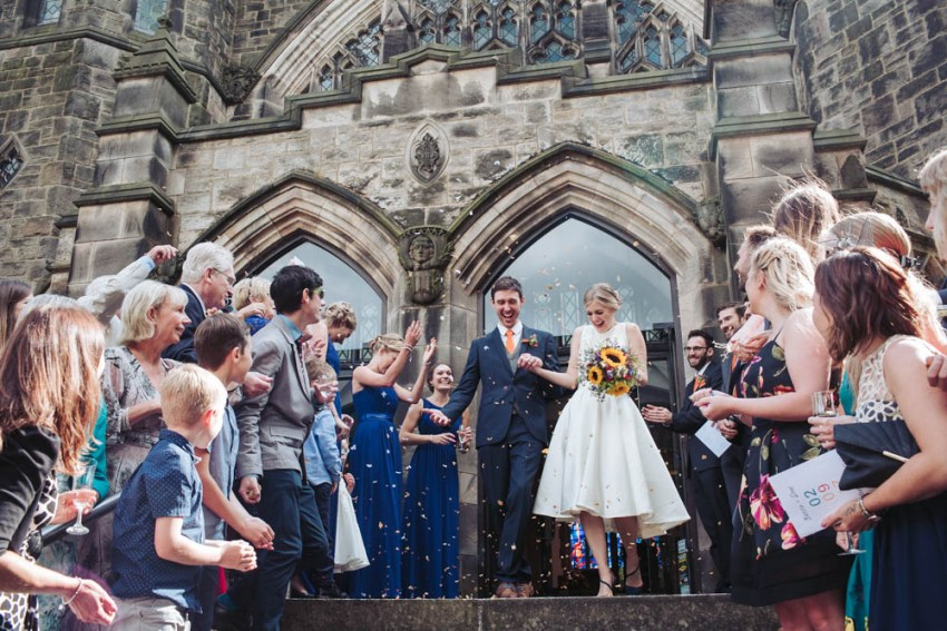 Confetti throwing at wedding at St. Andrews Church, Sheffield, Yorkshire.