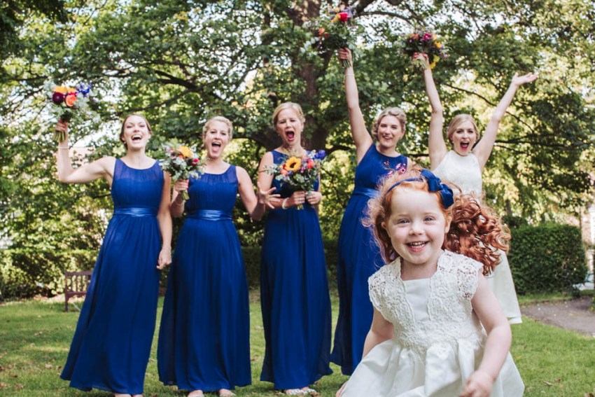 Bridesmaids in royal blue, flower girl and bride at St. Andrews Church wedding, Sheffield.
