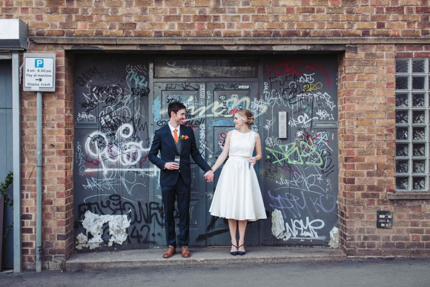 Trafalgar Warehouse wedding photography Sheffield Yorkshire. Bride and groom stood in graffiti doorway.