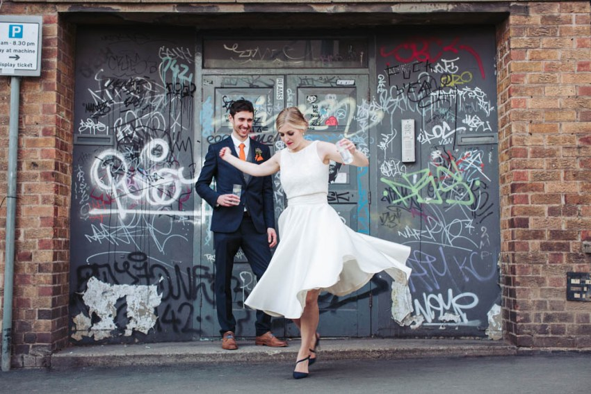 Trafalgar Warehouse wedding photography Sheffield Yorkshire. Bride twirls in wedding dress.