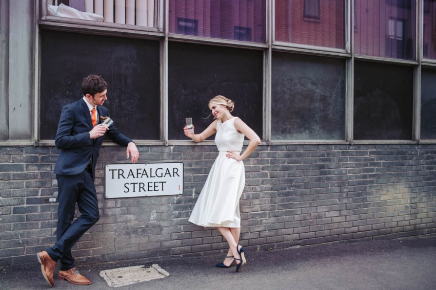 Trafalgar Warehouse wedding photography Sheffield Yorkshire. Bride and groom stood with Trafalgar Street sign.