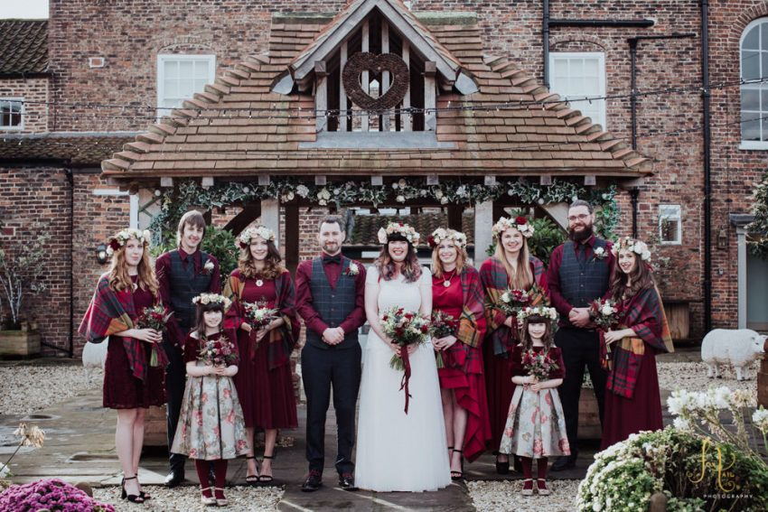 Hornington Manor photography York. Wedding party in burgundy red outfits.