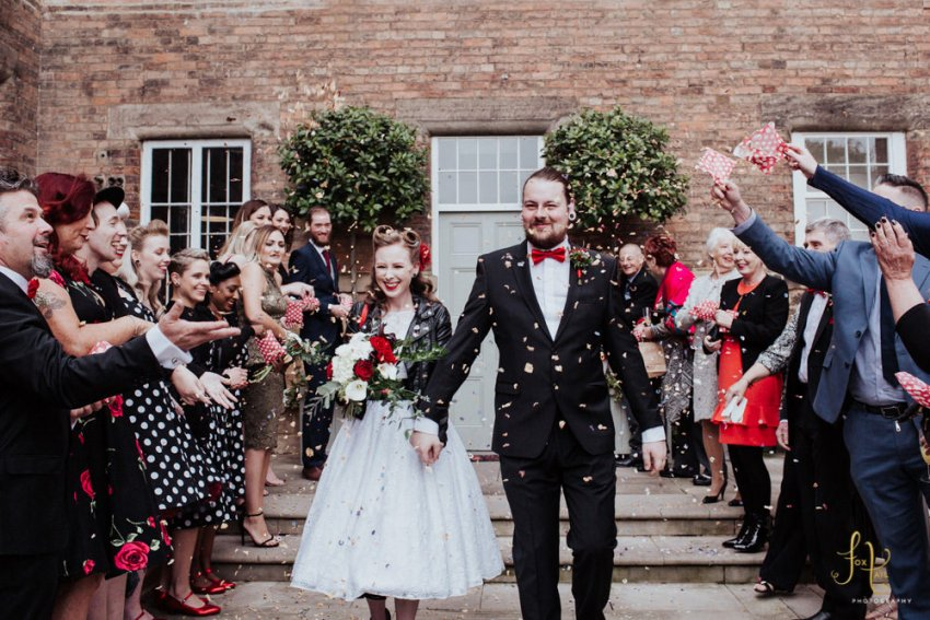 West Mill wedding photography. Guests throw confetti over the rockabilly newly weds in Derby.