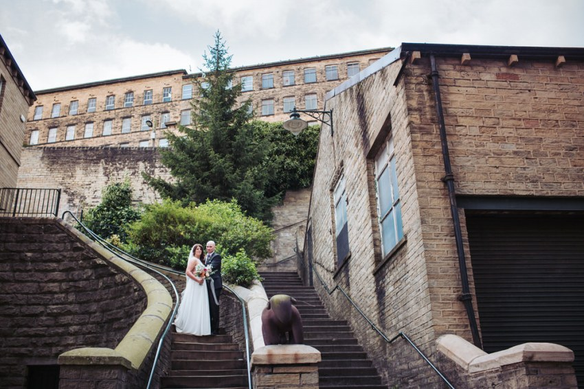 Industrial mill wedding venue backdrop. Portrait of bride and groom, the Arches in Yorkshire, Leeds photographer.