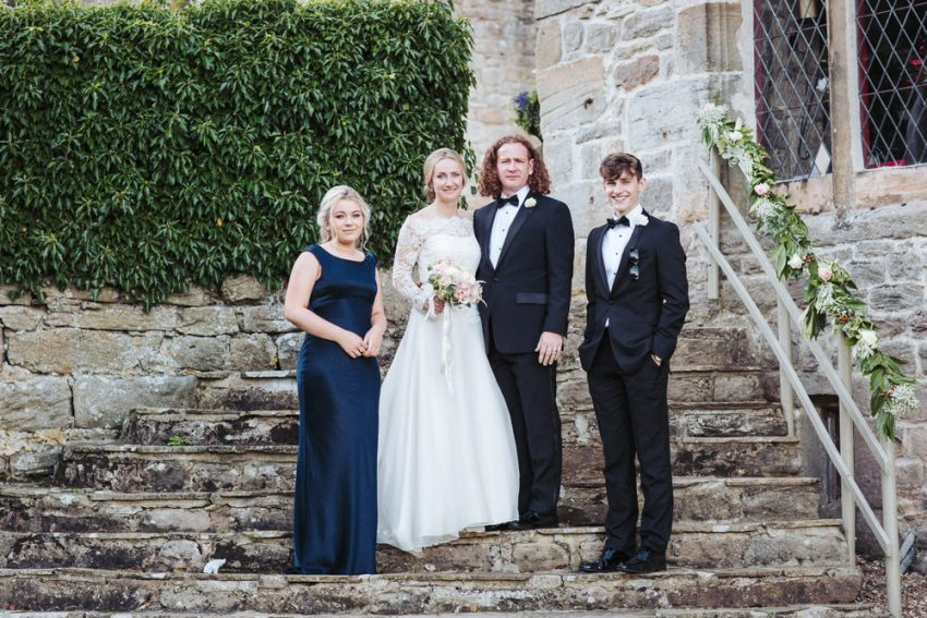 Barden Tower wedding family portrait on the steps of the Priest House.