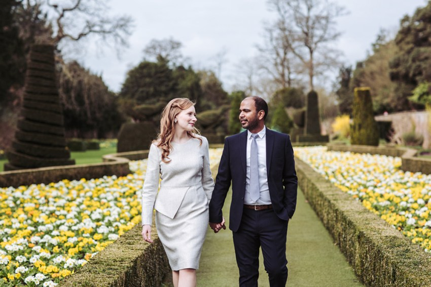 Cliveden House wedding photographer. Bride and groom walk through the gardens.