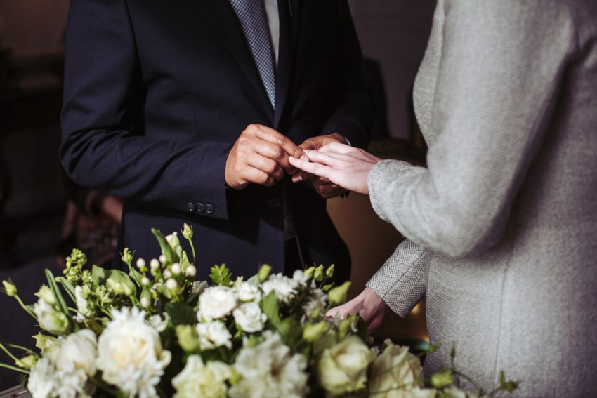 Exchange of rings during wedding ceremony.