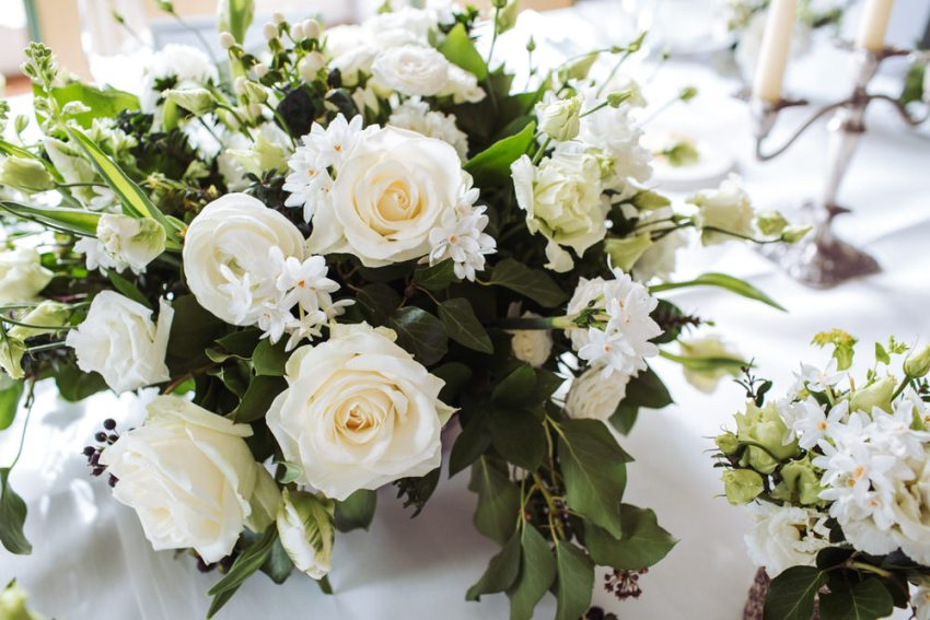 White roses and narcissus wedding table flowers at Cliveden House.