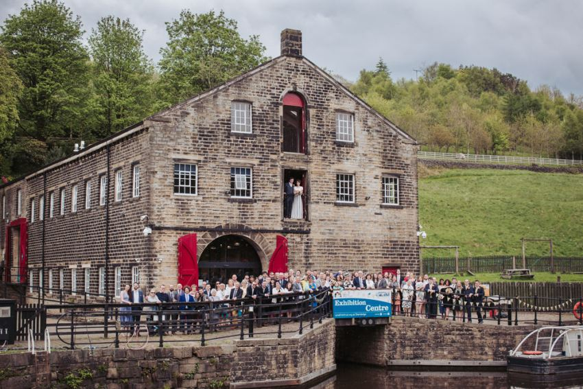 Standedge Tunnel visitors centre wedding venue. Group picture of all the guests by the canal.