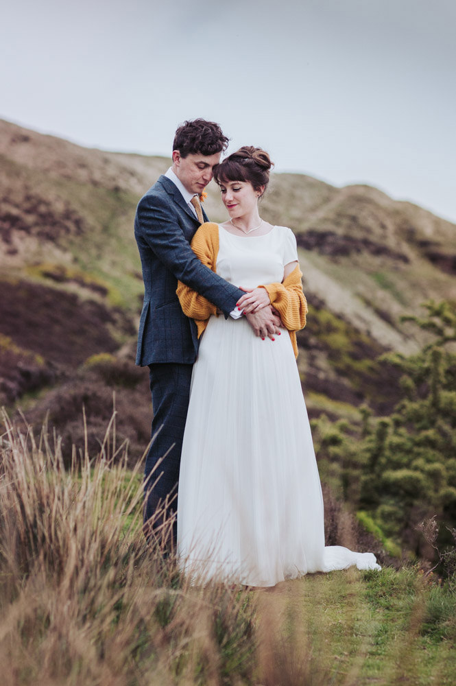 Standedge Tunnel wedding, bride and groom on moors by Huddersfield wedding photographer.