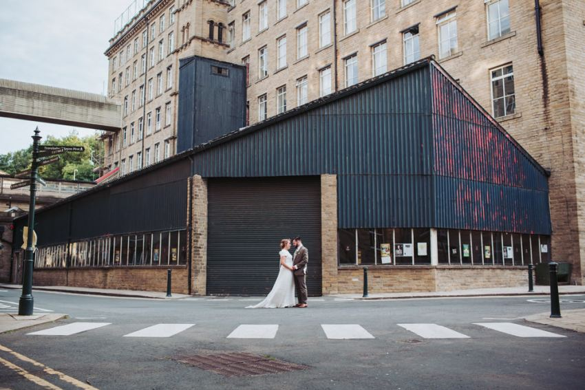 Arches wedding photographer. Bride and groom at industrial mill venue in Yorkshire.