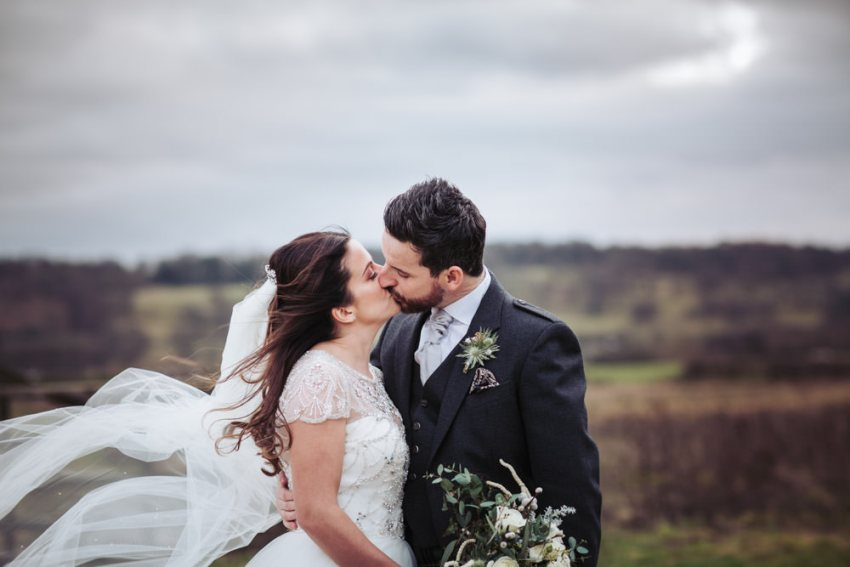 Wharfedale Grange wedding photography. Leeds. Bride and groom kiss.
