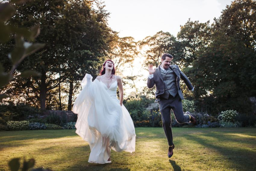 East Riddlesden Hall wedding. Best UK wedding photography. Bride and groom jumping.
