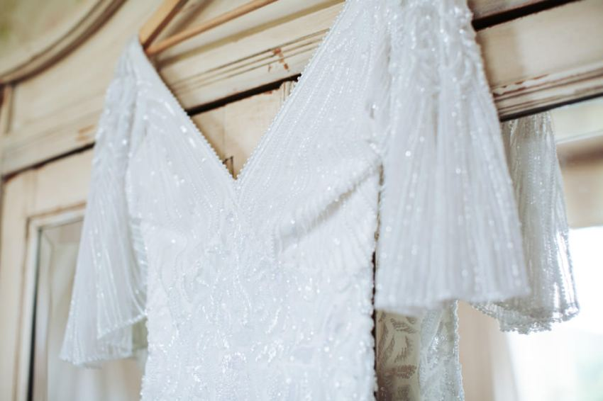 White beaded detail of the brides Eliza Jane Howell wedding dress.