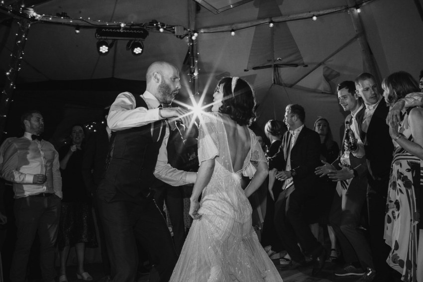 Bride and grooms first dance on the wedding tipi dance floor.