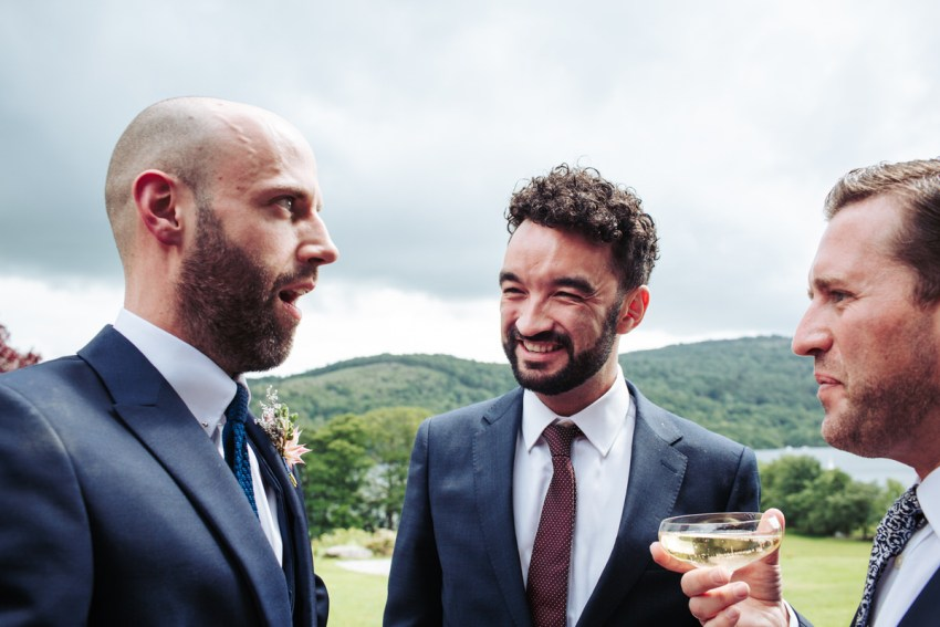 Groom pulls dumbstruck face at friends.