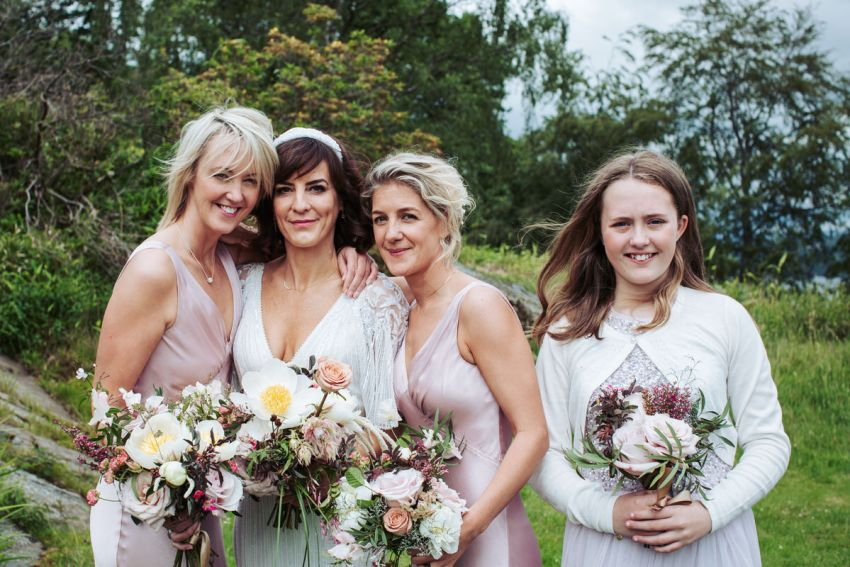 Bride poses with her bridesmaids at a Silverholme Manor wedding.