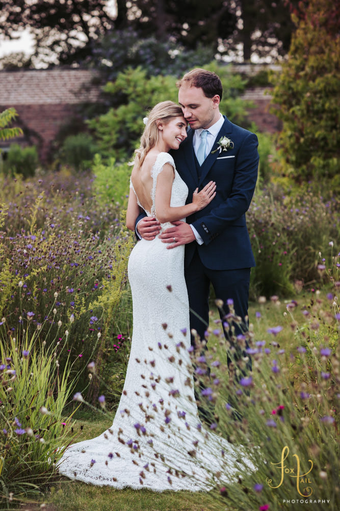 Fig House wedding, Middleton Lodge wedding photography. Romantic image of bride and groom embracing in a walled garden.