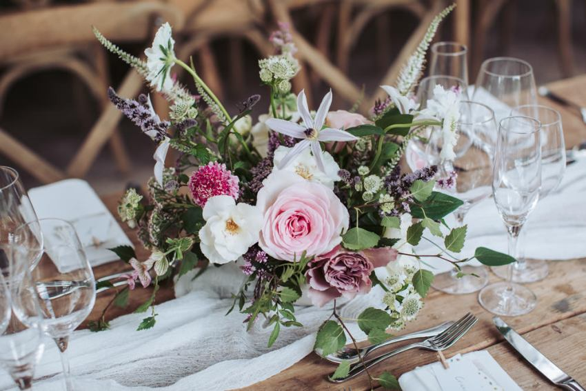 Romantic pink and white floral table centrepiece at the Fig House